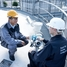 A customer and an Endress+Hauser Employee discussing on top of a tank